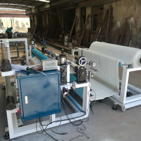 Slitter with winder and rewinder